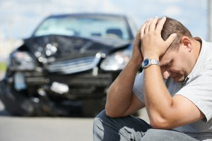 Adult upset driver man in front of automobile crash car collisio